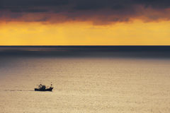 Fishing ship at sunset Royalty Free Stock Photo