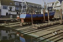 Fishing ship UK 264 at historic Shipyard Koffeman at former island Urk Stock Image