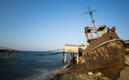 Fishing ship wreck resting on the shore Stock Images