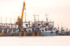 The fishing ships on a decline on a pier on Kamchatka Royalty Free Stock Image