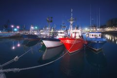 Fishing ships in Santurce port. At night royalty free stock photo