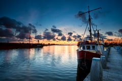 Fishing ships at sunset in Zoutkamp Royalty Free Stock Photo