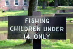 Fishing Sign. Directional Fishing Sign typical of those found in local, state and national parks stock photography