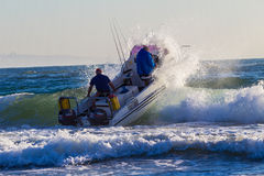Ski-Boat Crew Launch Wave Royalty Free Stock Images