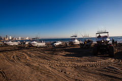 Fishing Ski-Boats Dawn Beach. Fishing surf Ski-boats getting ready to launch into the ocean surf stock image