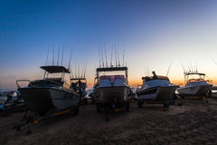 Fishing Ski-Boats Rods Dawn. Fishing surf Ski-boats and rods silhouetted at first light getting ready stock photo