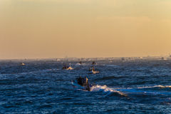 Fishing Ski-Boats Start Contest. Fishing surf Ski-boats at the start gun motor out to sea surf for the largest fish competition Durban royalty free stock photo