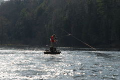 Fishing in small boat in river Stock Photos