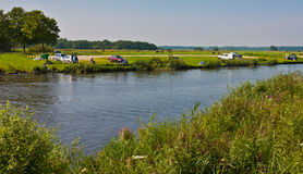 Fishing in a small river. Fishing on a hot summer day in the Dutch river Mark Stock Photos