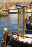 Fishing small white boats tied on a pier Royalty Free Stock Photos