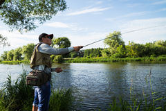 Fishing spinning on a beautiful river Royalty Free Stock Image