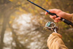 Fishing spinning on a beautiful river Stock Images