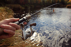 Fishing spinning in his hand Royalty Free Stock Photography