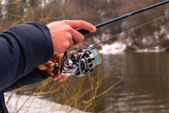 Fishing on a spinning winter Stock Photography