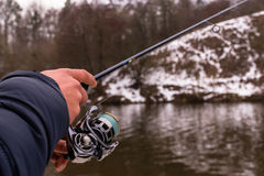 Fishing on a spinning winter Stock Photos