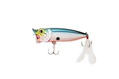 Fishing spoon-bait with hooks isolated. Fishing colour spoon-bait with hooks isolated on white Royalty Free Stock Image