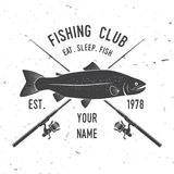 Fishing sport club. Vector illustration. Concept for shirt or logo, print, stamp or tee. Vintage typography design with fish rod and rainbow trout silhouette Stock Photo