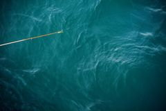 Fishing Stick Above Water Royalty Free Stock Image
