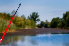 Fishing stick with blurred fishermans canal royalty free stock photography