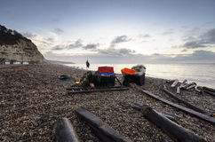 Fishing Stuff on the Beach in Devon. Fishing boxes and nets on the beachat sunrise at Beer in Devon Stock Photos
