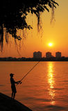 Fishing the sun. West Lake is a freshwater lake in the center of Hanoi, Vietnam. With a shore length of 17 km, this is the largest lake of the capital and a stock images