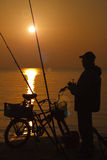 Fishing at sunrise. Royalty Free Stock Photo