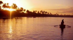 Fishing at Sunrise. A fishing boat at sunrise Stock Image