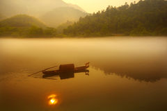 Fishing in sunrise. Fishing in fog and Lake  in the sunrise Royalty Free Stock Image