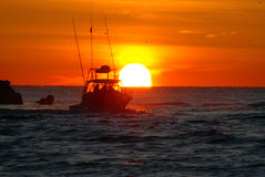 Fishing Sunrise. Fishing boat going out into ocean at sunrise royalty free stock photo
