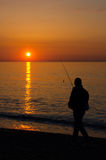 Fishing at sunrise in Barcelona Royalty Free Stock Image