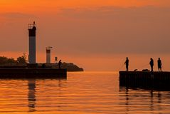 Fishing At Sunrise In Bronte, Ontario, Canada. Sunrise image taken on the shores of Lake Ontario at Bronte Beach in Oakville, Ontario, Canada stock photo