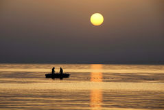 Fishing at sunrise Royalty Free Stock Image