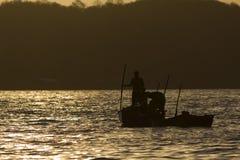 Fishing at Sunset. Men fish at sunset in Venezuela Stock Image