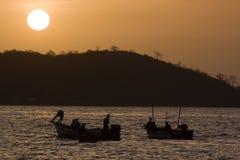 Fishing at Sunset. Men fish at sunset in Venezuela Stock Photos