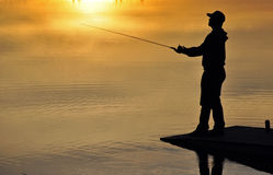 Fishing At sunset Royalty Free Stock Photo