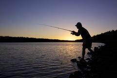 Fishing at Sunset Stock Photography