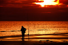 Fishing in the sunset Stock Image