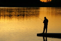 Fishing At sunset. A silhouette of a ficherman as the sunset on lower Stock Images