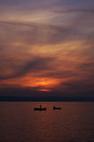 Fishing at sunset. Two fishing boats at sunset Stock Photo