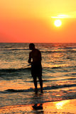 Fishing at sunset. Late day fishing. Madeira Beach Florida royalty free stock image