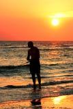 Fishing at sunset Royalty Free Stock Image