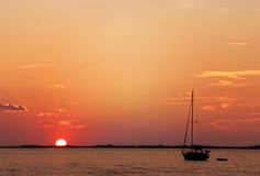 Fishing at sunset. Boat fishing as the sun sets Royalty Free Stock Photos