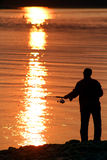 Fishing at Sunset Royalty Free Stock Photos