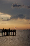 Fishing at Sunset. A fisherman casts a net at sunset at the fishing pier at Gilchrist Park in Punta Gorda Florida royalty free stock photo