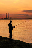Fishing at sunset. Dublin. A fisherman silhouette at sunset Stock Images