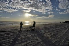 Fishing at sunset low light long shadows Royalty Free Stock Images