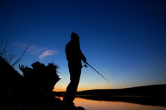 Fishing at sunset near the sea. In summer Royalty Free Stock Image