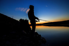 Fishing at sunset near the sea 2. Fishing at sunset near the sea in summer Stock Photography