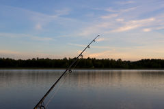 Fishing during sunset. Stock Photos