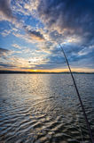 Fishing in sunset scenery Royalty Free Stock Image